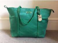 DESIGNER HANDBAG BY TUMI FOR SALE