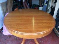 Solid wood cherry finish extending table and four chairs