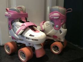 Rollerskates - adjustable sizes 8-11 & 12-2, 4 wheels, pink and white