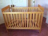 Marks and Spencer's Cot with as new mattress