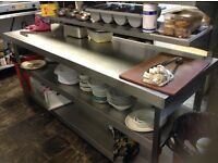 Stainless steel table with two tier shelving,£250.00