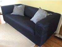 IKEA KLippan sofa and pouffe in black cotton drill