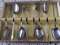Boxed Set of Apostle Tea Spoons and Sugar Tongs. Stainless Chrome Plate.