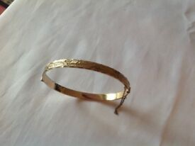 Gold tone bangle I think it's rolled gold £15 I can deliver if local call 07812980350