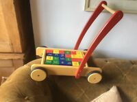 Child's push along cart with bricks