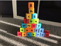Wooden lettered and numbered building blocks
