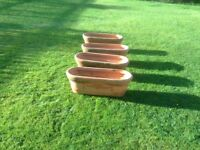 4 long terracotta colour plastic plant pots, great condition