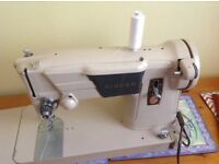 Singer Electric Sewing Machine in good working order.
