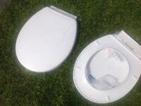 Brand new white soft close toilet seat