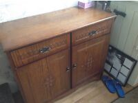 Dark brown sideboard. Nice side board very good condition with design on front