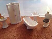 Dolls' house bathroom set, including shower, bath, toilet and 2 sinks.