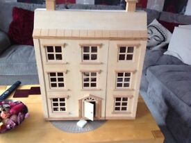 Lovely wooden dolls house with furniture and doll family