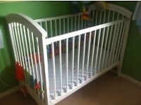 Wooden cot with mattress and bumper.