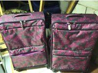 2 large lightweight wheeled suitcases