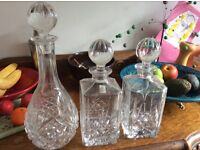 Three cut glass decanters