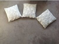 THREE PATTERENED NEXT CUSHIONS