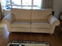 2 cream upholstered sofas -