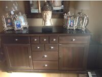 Large brown sideboard and leopard print mirror