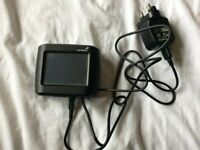 Tom tom GPS and pre loaded map, charging cable etc