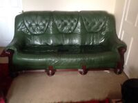 Green leather sofa & 2 chairs. Sofa has slight tear. Collection only