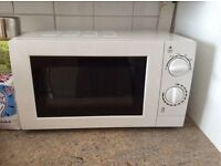 Microwave used once house clearance