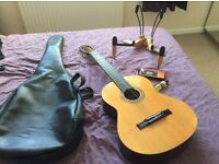 Full size guitar + stand + tuner/metronome + case