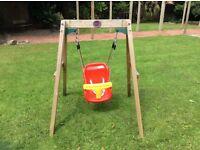 Used Plum wooden baby swing
