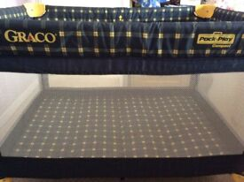 Graco Blue and yellow compact pack and play/travel cot