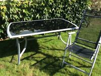 Garden furniture - glass top table and six chairs