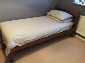 Single pine bed and mattress.