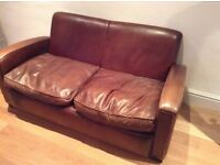 2 Seater brown leather sofa and footstool