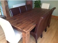 £330- Rustic plank style dark wood dining table & faux leather chairs