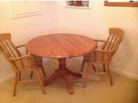 Solid pine pedestal round dining table & 2 carver chairs