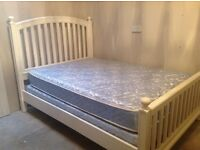 White bedroom set. Double bed with mattress, and matching chest of drawers