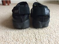 All black Nike Air Rift