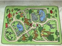 Childrens green play rug zoo theme in good condition rubber backed