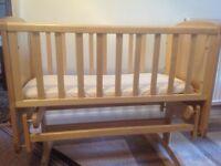 Wooden crib that rocks