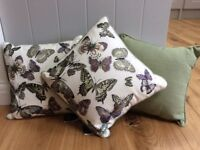 3x 30cm x 30cm butterfly patterned cushions.