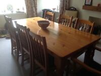 Large traditional pine table and chairs