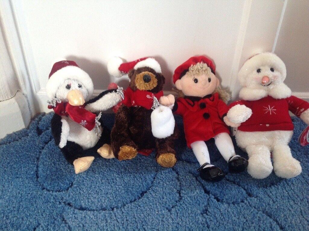 Set of four Christmas soft toys