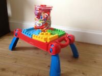Mega Bloks table and selection of bricks