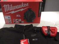 Milwaukee heated coat and charger never worn.xl
