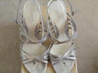 Silver strappy sandals and clutch bag
