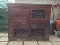 Free double rabbit hutch,made out of wooden crates. Heavy and hard wearing. Pick up only.