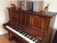 Gresham upright piano and piano stool with storage.