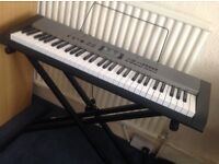 CTK-1300 Casio Keyboard with an X stage piano stand