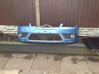 Ford focus front bumper in blue with front fogs crome trim