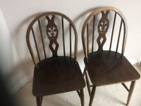 TWO USED DINING CHAIRS BY ERCOL IN DARK WOOD (sorry no offers)