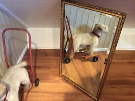 A very old bevell edged mirror.