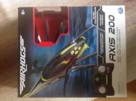 Radio controlled helicoptor (Airhogs Axis 200) for sale (new/unopened)
